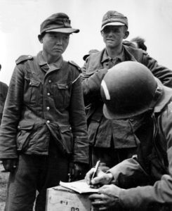 Yang Kyoungjong in Wehrmacht uniform following capture by American paratroopers in June 1944 after D-Day